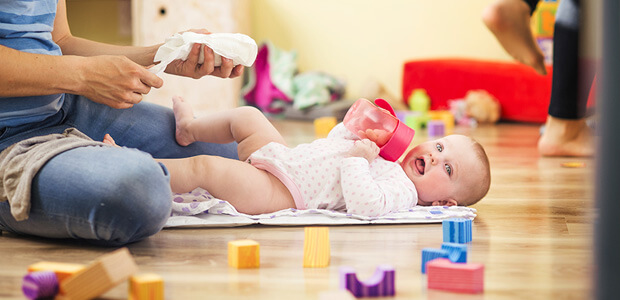 Baby playing on floor