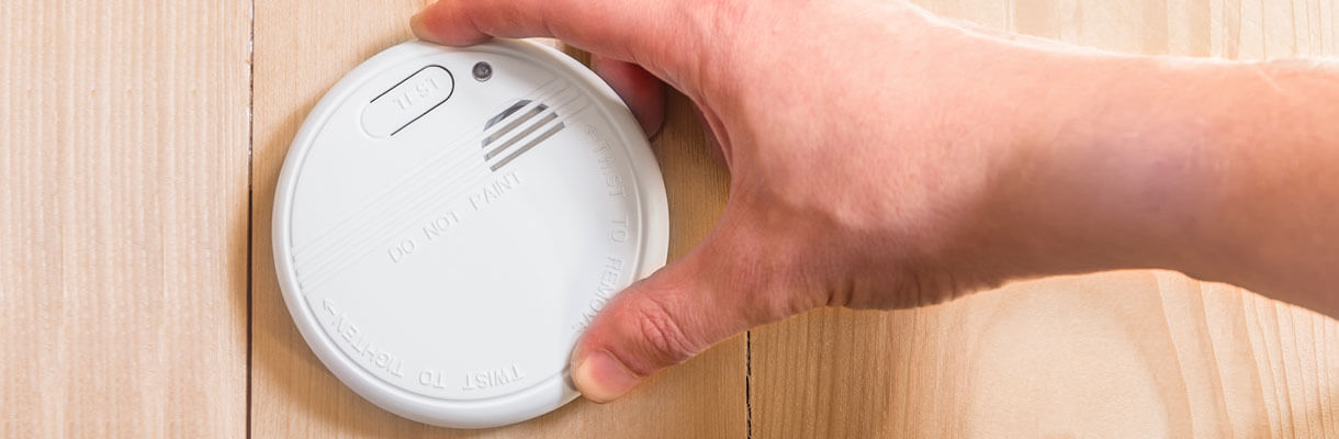 Attaching carbon monoxide detector on a wooden wall