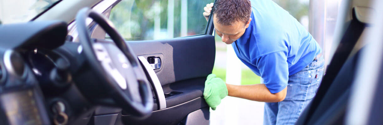 Cleaning inside of a car with a hand towel