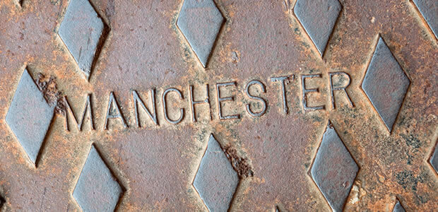 Drain cover with 'Manchester' stamped on it