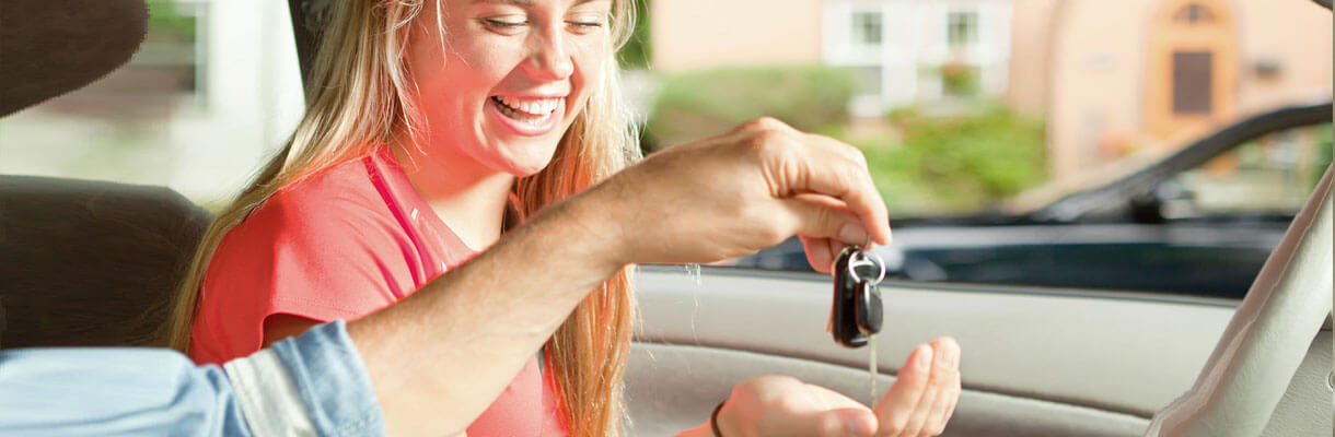 Young woman handed car keys