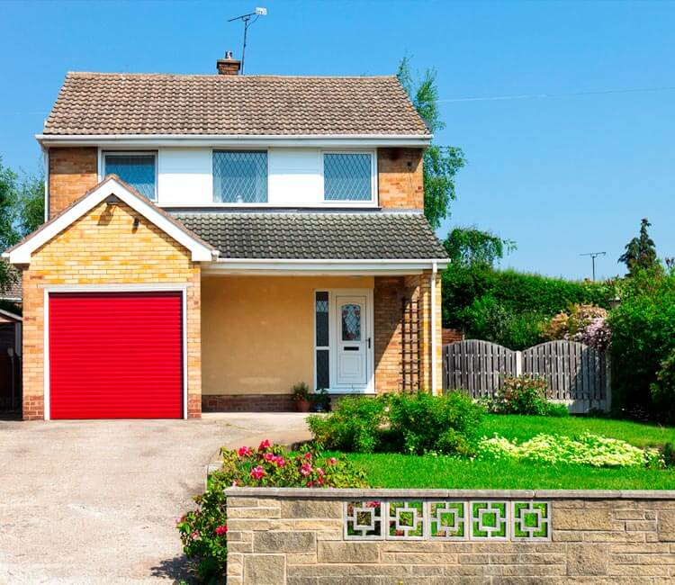 Picture of a suburban home with red garage door