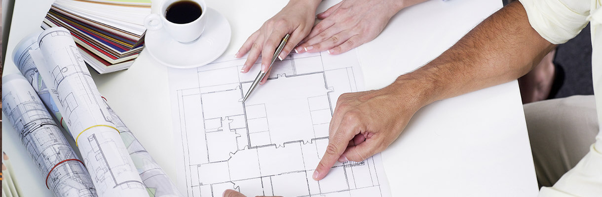 Man and woman reviewing architect drawings