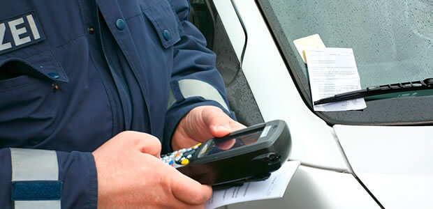 European traffic police officer giving a ticket using an electronic console