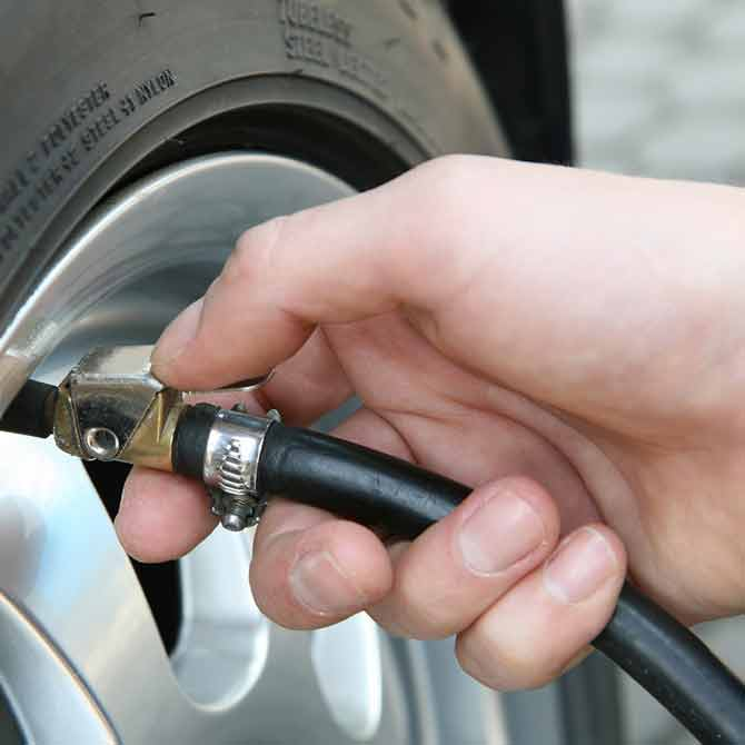 Pumping up tyre with air pressure