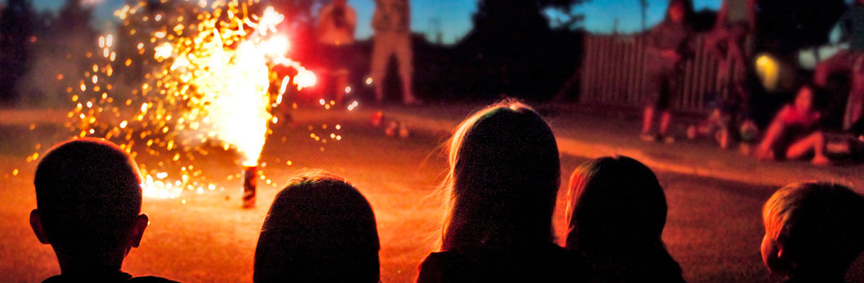 Kids watching fireworks in the street