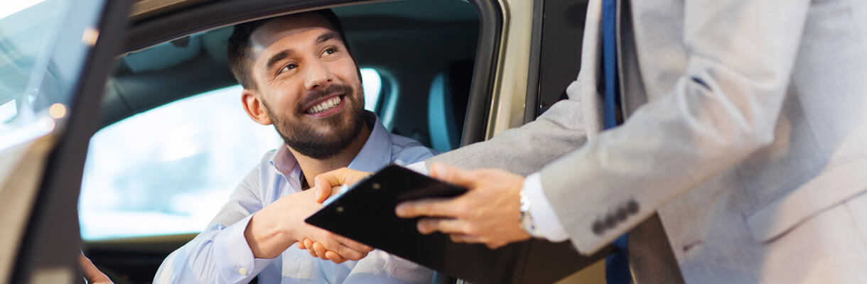 Happy man shaking hands with salesman