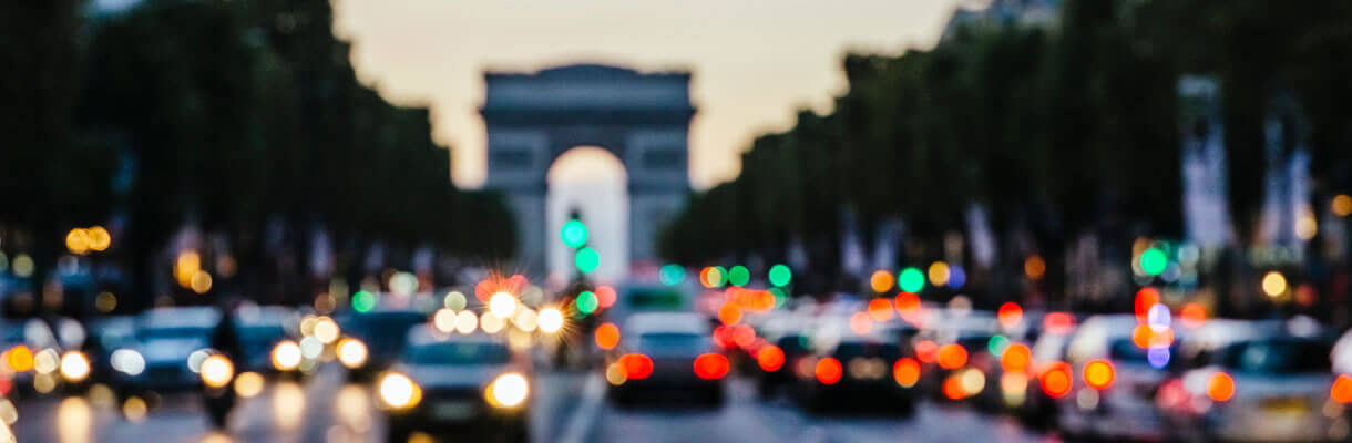Cars in traffic on Champs Elysees in France