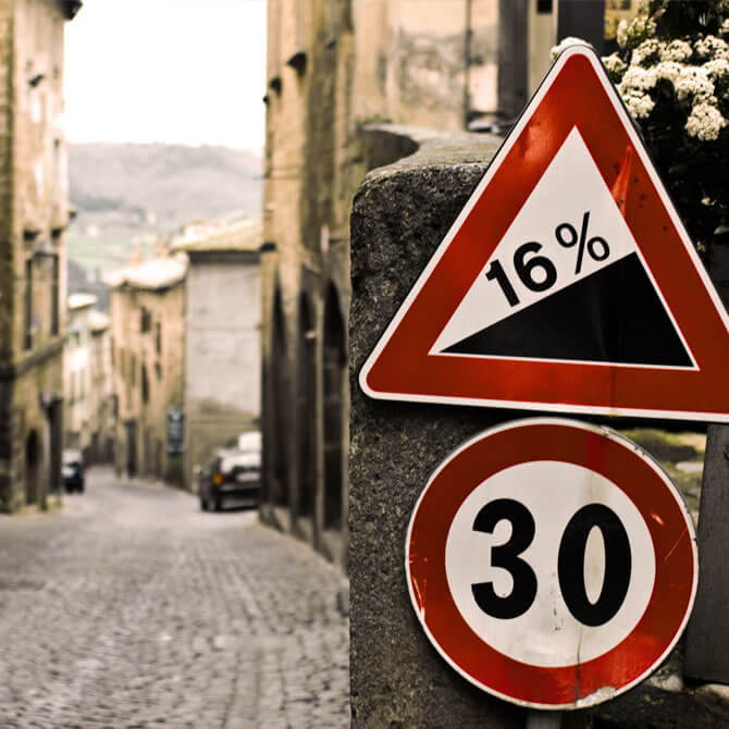 Cobbled street with 30 miles per hour road sign