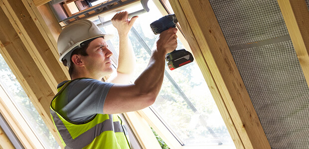 Builder working on a loft conversion
