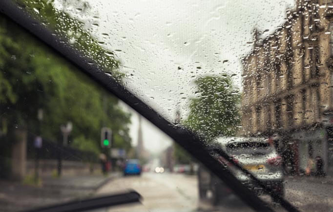 Windscreen wipers working in the rain