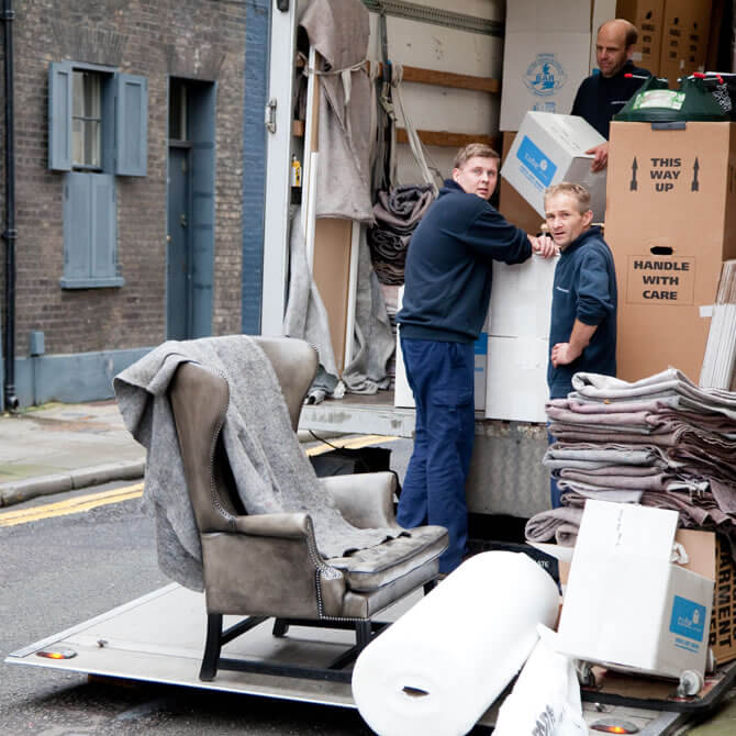 Removal men offloading items from their truck
