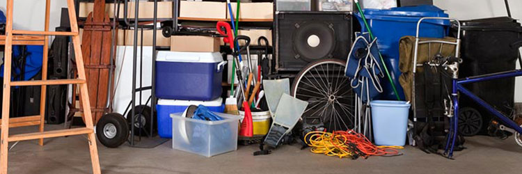 Untidy garage with various items