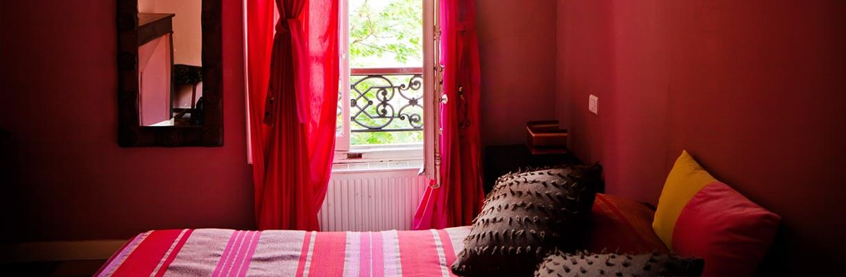 Red bedroom with white radiator and window