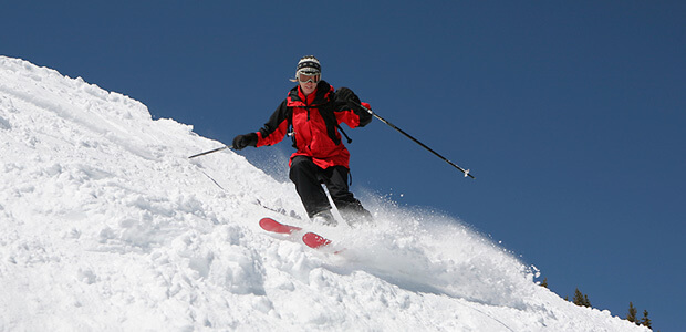 Advanced skier on a steep slope