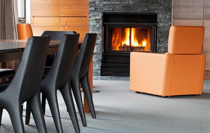 Living room - black dining table, orange sofas and fireplace