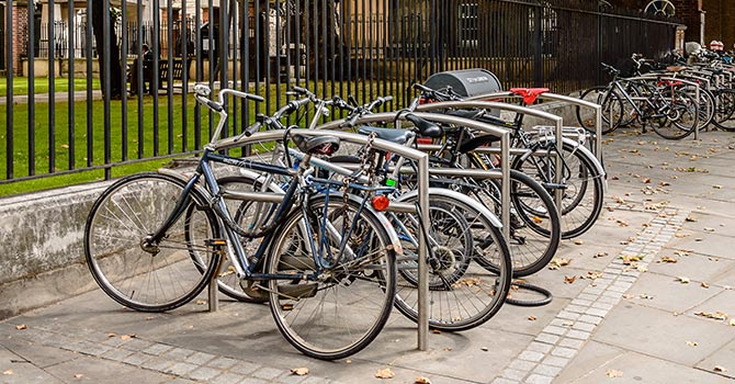 Bike racks - silver public by railings