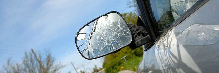 Smashed car left wing mirror